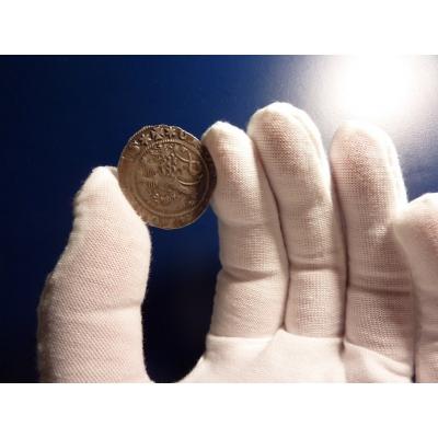 Handschuhe für den Umgang mit Münzen