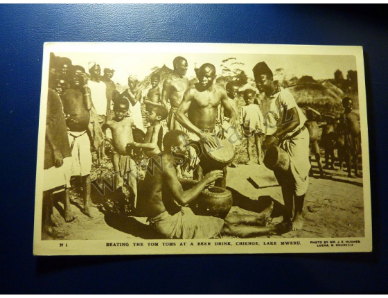 Rhodesia - Beating the Tom toms at a beer drink, Chienge, Lake Mweru